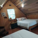 second-floor-bedroom-loft-two-queen-beds-child-area_1.jpg