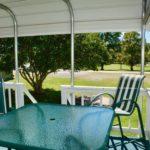 outside-patio-table-chairs-big-yard.jpeg