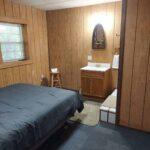 basement-bedroom-side-view-bathroom-bed-together_1.jpg