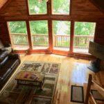 living-area-hdtv-balcony-large-windows.jpg