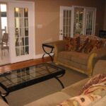 sunset-cottage-living-room-spacious-couch-clean-comfy-family-time.jpg