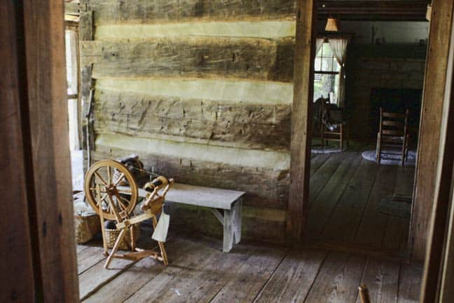 1850s Homeplace Spinning Wheel and Cabin Interior