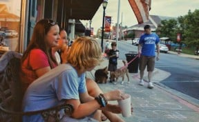 Teens eating ice cream in the Summer in downtown Cadiz