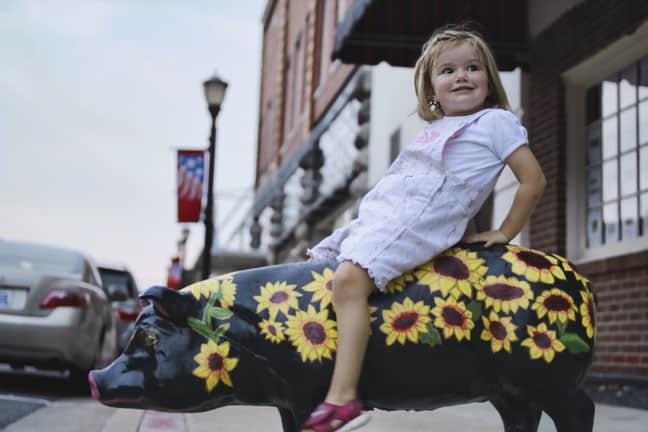Little Girl on Concrete Pig