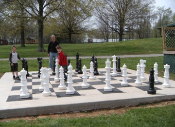 Family playing chess on Huge Chess Board