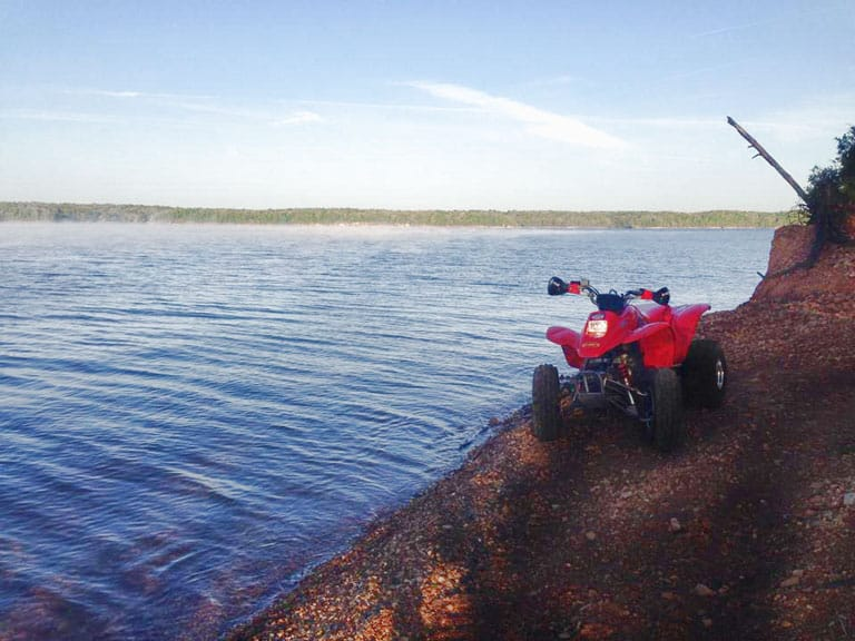 ATV Parked by Lake Barkley on off road trail